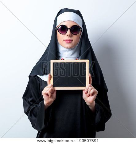 Young Serious Nun With Board