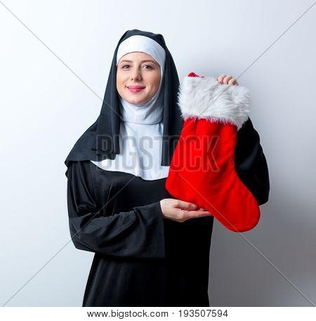 Young Smiling Nun With Christmas Sock