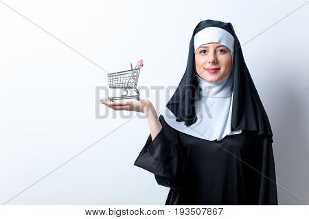 Young Smiling Nun With Shopping Cart