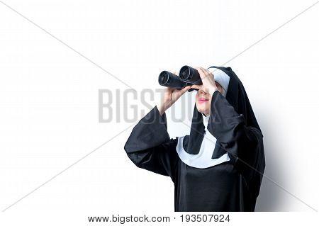 Young Smiling Nun With Binoculars