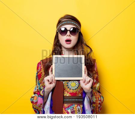 Young Hippie Girl With Sunglasses And Board