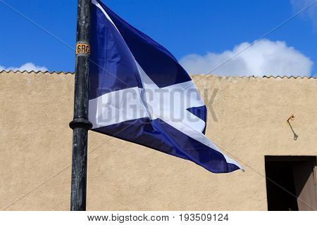 Scottish flag waving in the wind, United Kingdom
