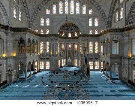 Istanbul, Turkey - April 20, 2017: Interior of Nuruosmaniye Mosque an Ottoman Baroque style mosque completed in 1755 with a huge dome & many colored stained glass windows located in Shemberlitash Fatih Istanbul Turkey
