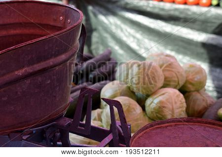 Close view on the old scale on fruit and vegetable market with the original market background