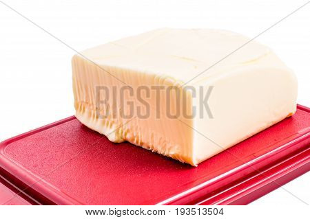 Butter in red  butter dish isolated on white background