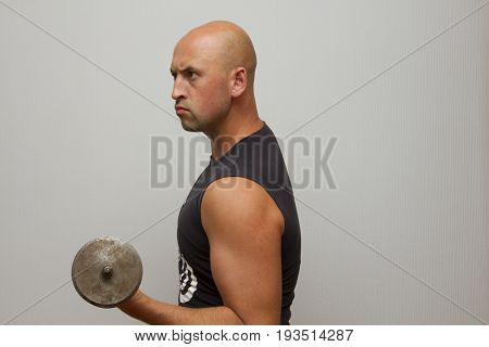 Aggressive guy athletic build Young athlete Training of hands.