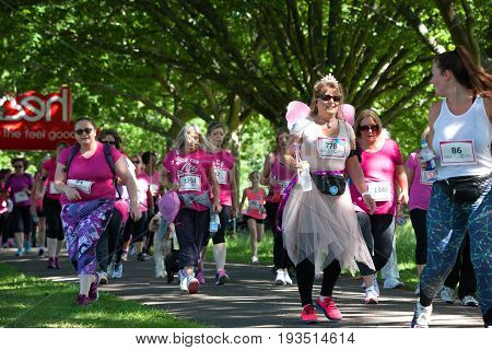 SOUTHAMPTON UK - July 2 2017: Race for Life women run and walk to raise money for Cancer Research charity in Southampton UK. Lady dressed up as a fairy.