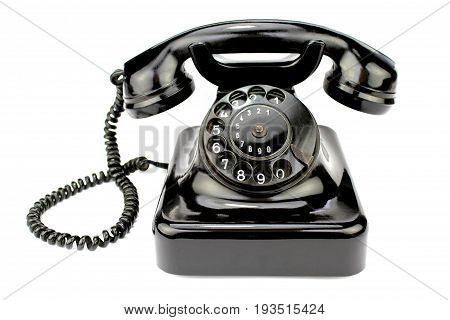 Old rotary phone on white background .