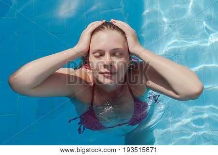 Smiling Young Woman In The Pool With Closed Eyes. Concept Rest, Summer, Relaxation, Pleasure, Pleasu