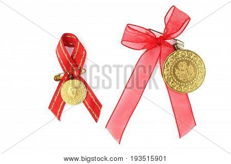 Turkish traditional coins with red ribbon. Quarter and half gold