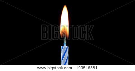 Blue candle in dark close up image