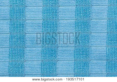 Blue microfiber duster. Microfiber fabric texture background.