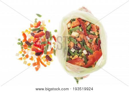 Mix of deep-frozen vegetables in cellophane package. Studio Photo