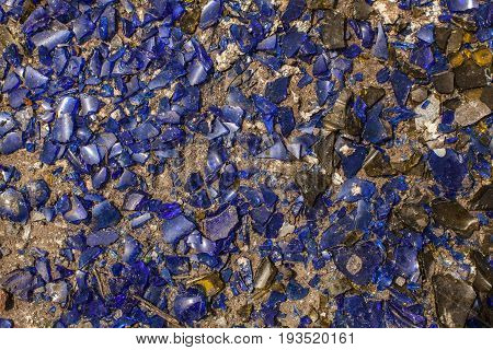 Many Broken Pieces Of Glass In Blue