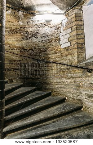Ancient spiral staircase in the tower, vertical image