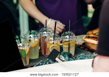 Lemonade With Mint And Lemons On Table, Space For Text. Street Food Festival. Drink Bar At Wedding R