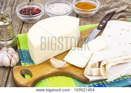 Pita bread with suluguni cheese for shawarma. Studio Photo