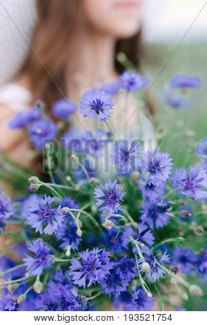 Series. Portrait of a beautiful romantic girl in a magical lavender field with a bouquet of lavender
