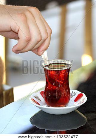 Turkish tea with traditional tea glass close up image