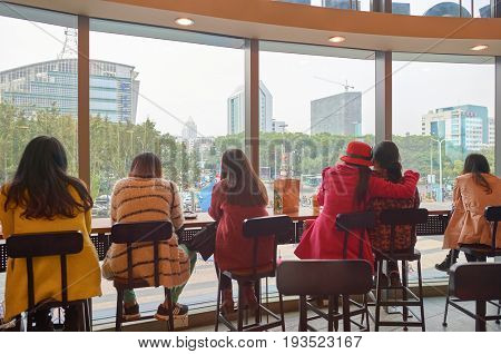 SHENZHEN, CHINA - JANUARY 11, 2015: people at Starbucks coffee shop in ShenZhen.