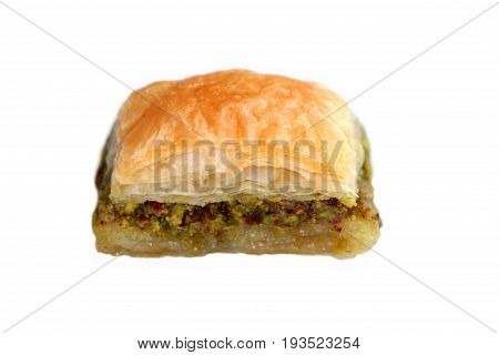 Turkish baklava with pistachio nuts isolated on white background.