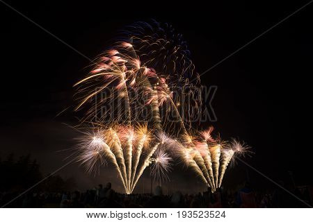Colorful And Festive Fireworks Bursting And Glowing In Night Sky