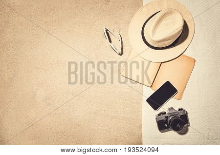 Top view photograph of sandy beach. Frame composition. Vintage effect background with copy space. Frame for advertising or concepts