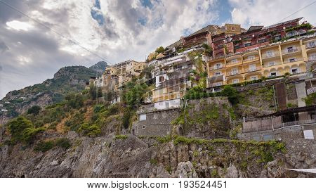 Panoramic view of buildings on a cliff in Positano town Campania Italy