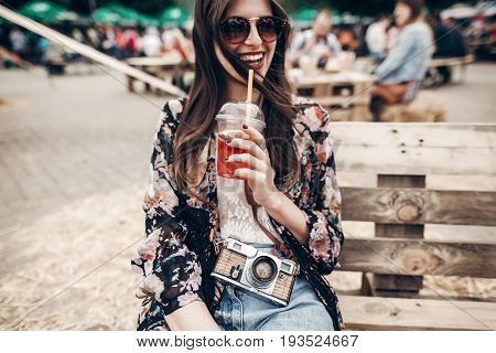 Happy Stylish Hipster Woman In Sunglasses With Lemonade. Boho Girl In Denim And Bohemian Clothes, Ho
