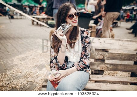 Stylish Hipster Woman In Sunglasses With Red Lips Holding Lemonade And Old Photo Camera. Boho Girl H