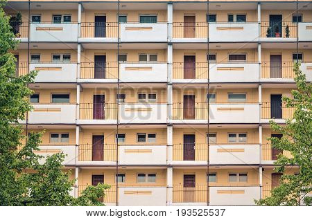 Facade of a residential building. Galleries with doors in communist construction.