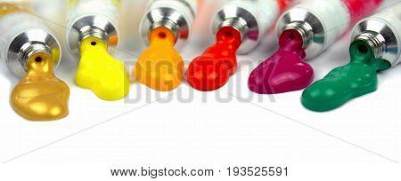 Paint tubes on white background close up image