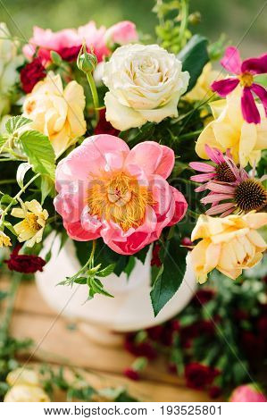 nature, floral design, arts and crafts, wedding, summer concept - clean colored bouquet with tender english roses and delicate yellow avalanches, peonies coral charm and dianthuses