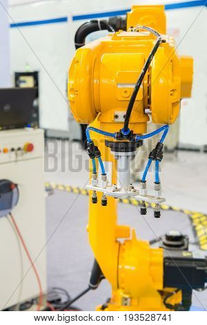 Industrial robot with vacuum suckers with conveyor in manufacture factory,Smart factory industry 4.0 concept.