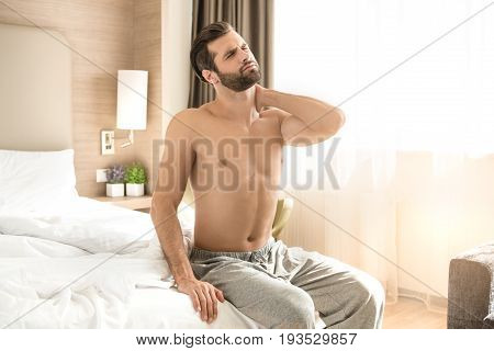 Young male traveler tourist hotel accomodation neck pain