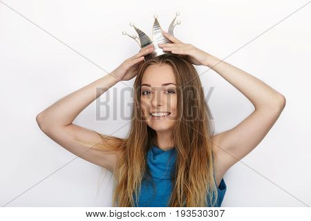 Headshot Of Young Adorable Blonde Woman With Cute Smile In Hand Made Princess Crown On White Backgro
