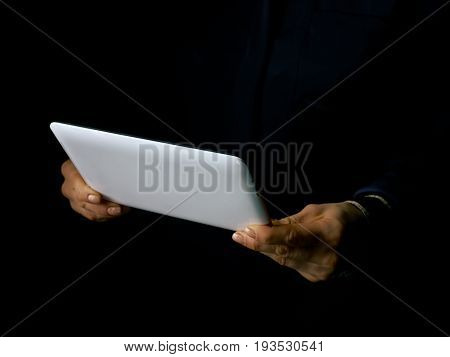 Woman Hands Isolated On Black Using Tablet Pc
