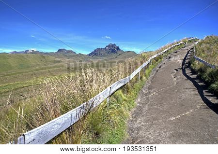 Beautiful scene of the Ecuadorian Andes, on a sunny day, with a walk trail on the side