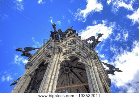 Low view of one of the many towers in the Basilica de Quito church, and it's many bird gargoyles