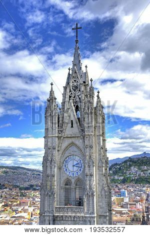 Steeple of the Basilica Church in Quito, Ecuador, at daytime, on an overcast day.