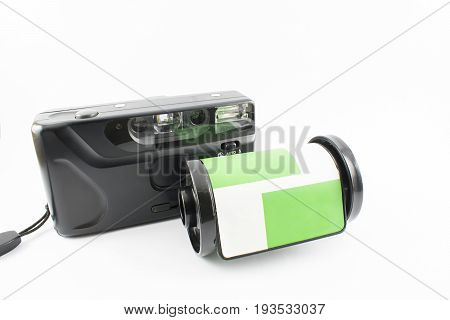 Old photo camera and rolls on a white background.