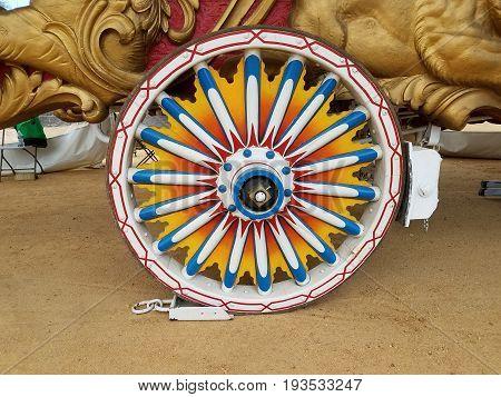 rainbow colored very colorful old wood wagon wheel