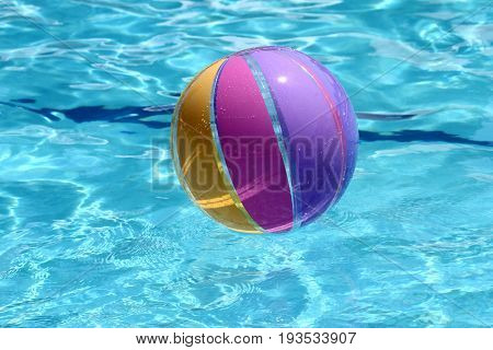 Beachball and swimmingpool. sommer vacation close up image