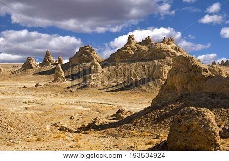The Trona Pinnacles are an unusual geological feature in the California Desert National Conservation Area. The unusual landscape consists of more than 500 tufa spires some as high as 140 feet rising from the bed of the Searles Lake basin.