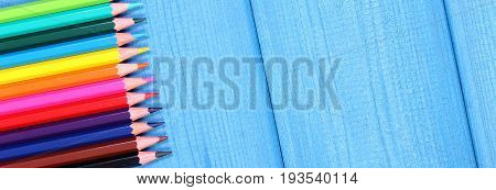 Colorful Crayons, School Accessories, Copy Space For Text On Blue Boards