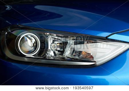 Bright shiny car headlight close-up. New clean led car light