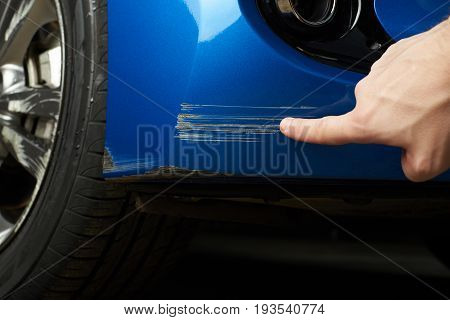 Car bumper deep scratch on blue paint