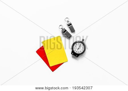 Yellow and red cards, stopwatch, whistle on white background top view copyspace.