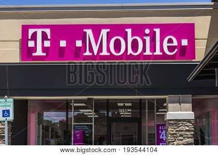Indianapolis - Circa July 2017: T-Mobile Retail Wireless Store. Deutsche Telekom is T-Mobile's majority shareholder VIII