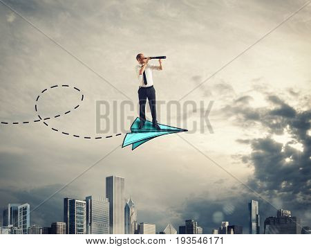Businessman looks through binoculars from above a paper plane. 3D Rendering